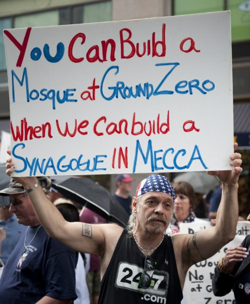 Demonstrators attend a rally with the Coalition to Honor Ground Zero August 22, 2010 in New York. The rally was held to oppose the construction of an Islamic Center and mosque near Ground Zero. AFP PHOTO/DON EMMERT (Photo credit should read DON EMMERT/AFP/Getty Images)